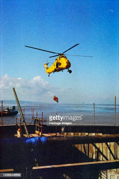 Rescue helicopter hovering over the Second Severn Construction site during an emergency rescue exercise. This photograph is from a batch appearing to...