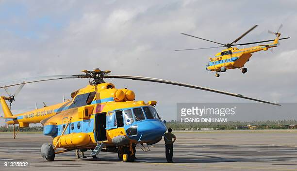 A rescue helicopter takes off carrying relief aid to floodhit areas in central Vietnam at Da Nang airport on October 1 2009 The death toll in Vietnam...