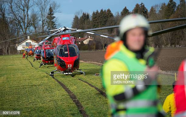 Rescue helicopters are ready to fly to the site of a train accident on February 9 2016 near Bad Aibling southern Germany Two commuter trains collided...
