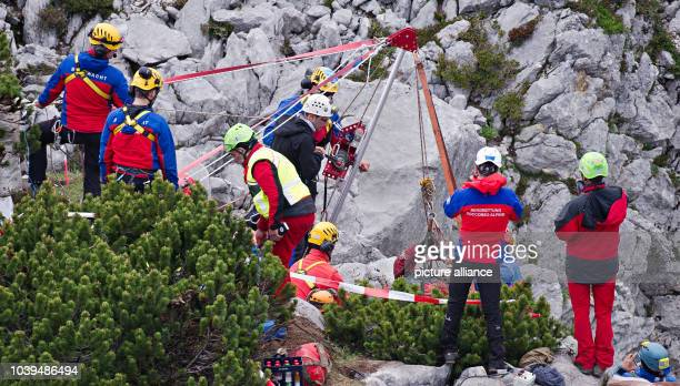 Rescue helpers pull rescue cave explorer Johann Westhauser from the Riesending cave at Untersberg mountain near Marktschellenberg Germany 19 June...