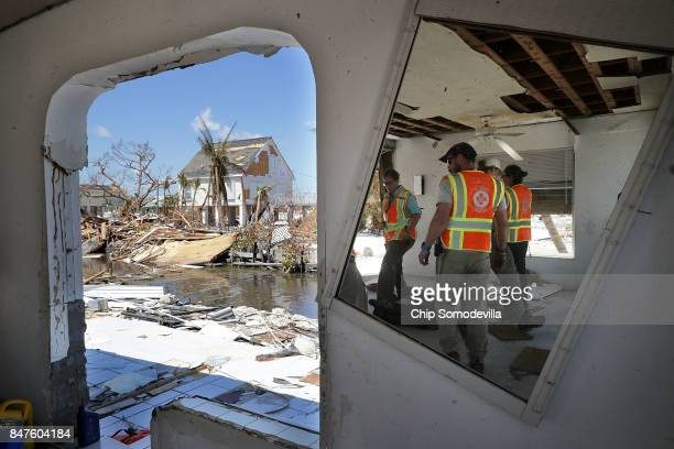 Rescue nurses and volunteers from What's Next Adventures search for people in a waterfront neighborhood hard hit by Hurricane Irma September 15 2017...