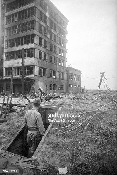 Rescue officer enters an air-raid shelter near the Chugoku Newspapers new building is blown off by the atomic bomb in August, 1945 in Hiroshima,...