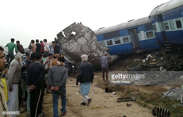 Rescue officials on the spot where 14 coaches of the IndorePatna express derailed killing around 90 people and injuring 150 in Kanpur