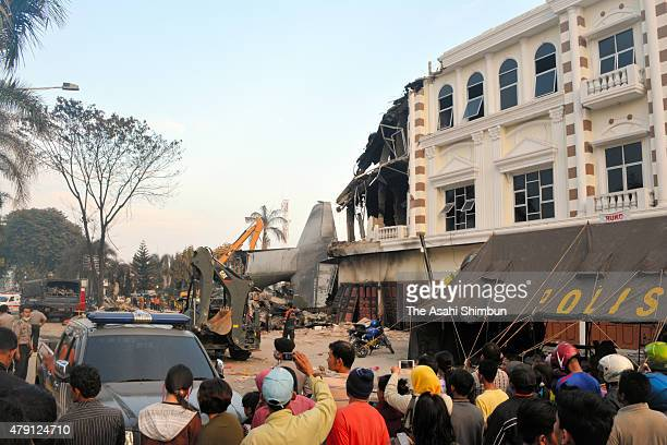 Rescue operation continues after a military transport plane crashed into a building on July 1 2015 in Medan Indonesia Over 30 bodies have been...