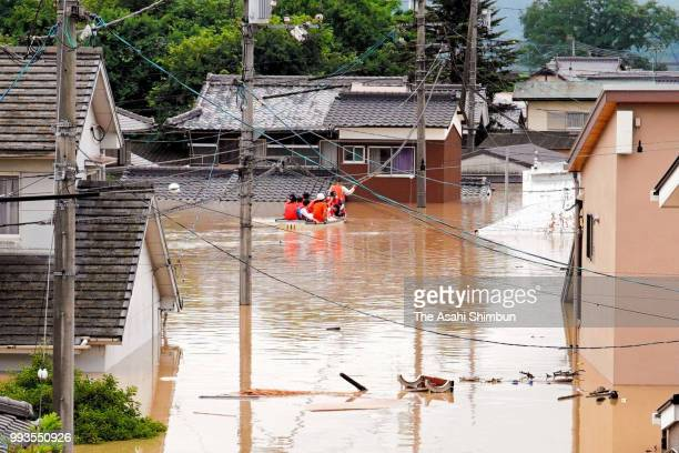 Rescue operation continues as the Mabicho area is submerged after Odagawa River banks collapse due to heavy rain on July 7 2018 in Kurashiki Okayama...