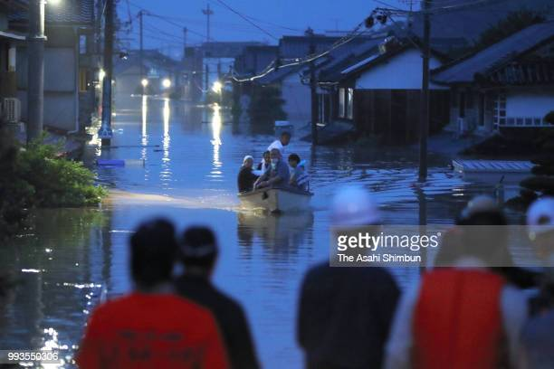 Rescue operation continues at night as the Mabicho area is submerged after Odagawa River banks collapse due to heavy rain on July 7 2018 in Kurashiki...