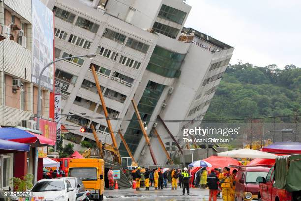 Rescue operation continues while steel pillers are set to hold a leaning building on February 8 2018 in Hualien Taiwan At least seven people were...