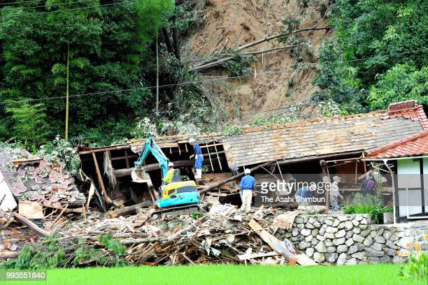Rescue operation for missing two people continues at a house where a landslide hit after heavy rain on July 7 2018 in Takehara Hiroshima Japan 51...