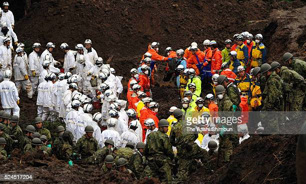 Rescue operation of the missing continues by police officers, fire fighters and Japan Ground Self-Defense Force members on April 24, 2016 in...