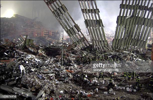 Rescue operations at Ground Zero; Firefighters finding victims and searching for survivors at the wreckage of the World Trade Center Towers following...