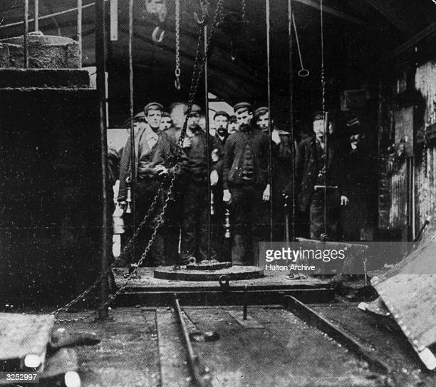 A rescue party waiting to descend the mine shaft in the worst Welsh mining disaster for 11 years at the Wattstown Colliery in the Rhondda Valley...