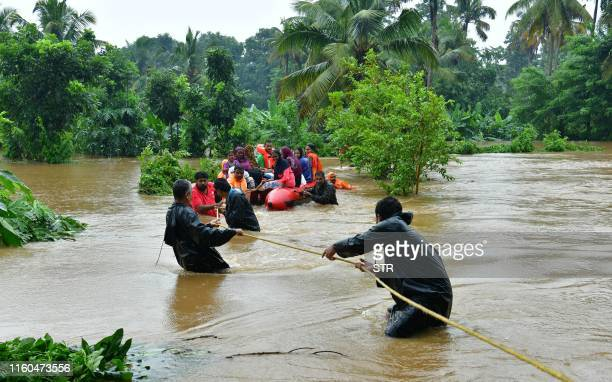 Rescue personals evacuate families affected by floods at Eloor, in Ernakulam district, in the Indian state of Kerala on August 9, 2019. - Floods that...