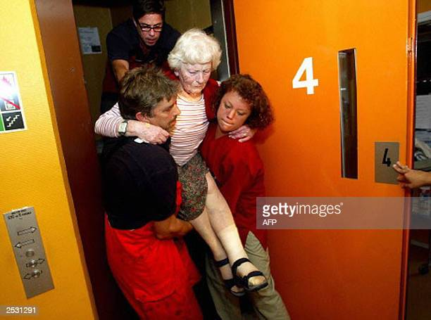 Rescue personel carry an elderly lady out of an elevator at Fregatten a block of service flats for old people in Karlskrona southern Sweden 23...