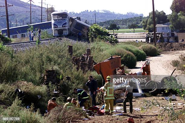 Rescue personel tend to an injured occupant of a truck that was hit by an Amtrak train near Moorpark Saturday killing on person the other person in...