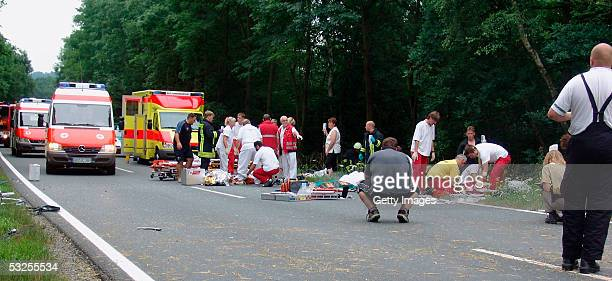 Rescue personel work at the scene of a fatal accident involving some of Australia's top women cyclists near the town of Gera on July 18 2005 just...
