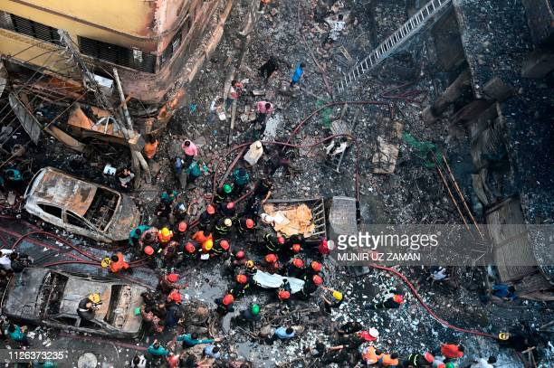 TOPSHOT Rescue personnel carry the body of a victim after a fire broke out in Dhaka on February 21 2019 At least 69 people have died in a huge blaze...