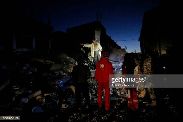 TOPSHOT Rescue personnel conduct search and rescue work following a 73magnitude earthquake at Sarpole Zahab in Iran's Kermanshah province on November...