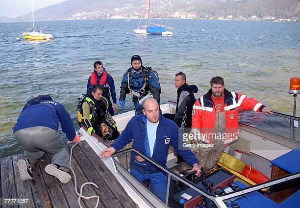 Rescue personnel return from searching for a missing member of a film crew on lake Tegernsee after a canoe carrying three people capsized during the...