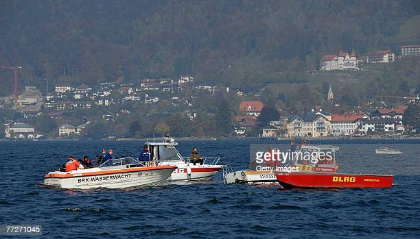 Rescue personnel search for a missing member of a film crew on lake Tegernsee after a canoe carrying three people capsized during the shooting of a...