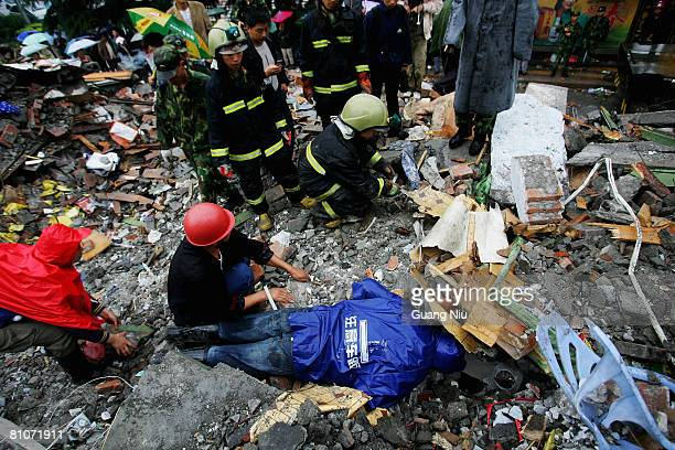 Rescue personnel search for people buried in a collapsed building following yesterday's earthquake May 13 2008 in Sichuan province Dujiangyan City...