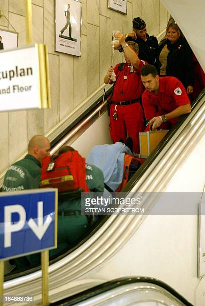 Rescue personnel take care 10 September 2003 of Swedish Foreign Minister Anna Lindh lying on a stretcher inside the NK department store in central...