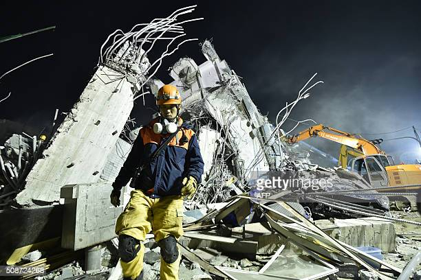 TOPSHOT Rescue personnel work at the site of a collapsed building in the southern Taiwanese city of Tainan on February 6 2016 following a strong...