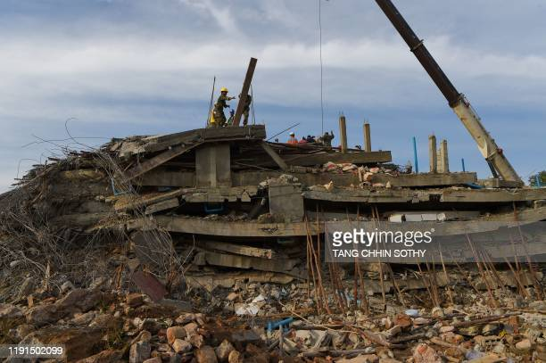Rescue personnel work at the site where an under-construction building on January 3 collapsed, trapping and killing workers, in southern Cambodia's...