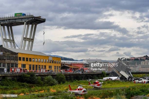Rescue services attend the scene at the Morandi bridge which collapsed on August 14 2018 in Genoa Italy At at least 22 people have died when a large...
