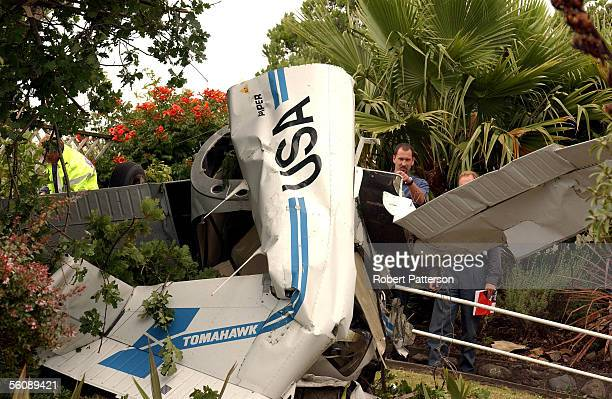 Rescue services attend to a two seater Piper Tomahawk which crashed into a garden in Tennis Court Road Raumati Kapiti Coast at 1pm killing the sole...