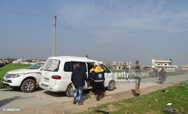 Rescue staff stand near a vehicle after Russian airstrikes hit Mishmishan village of Idlib's Jisr alShughur district in Syria on February 07 2018...