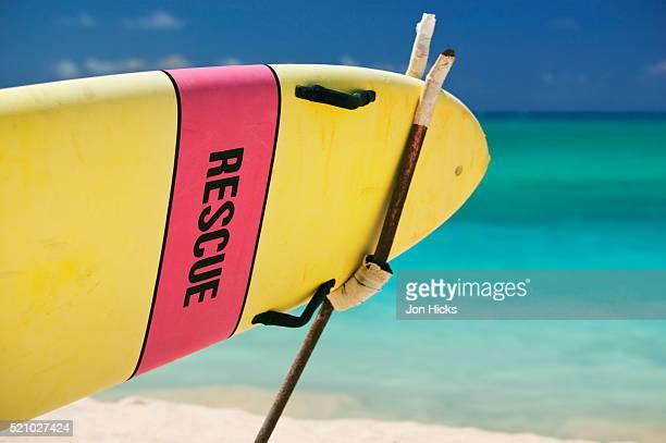 rescue surfboard on kailua beach park - kailua beach stock photos and pictures
