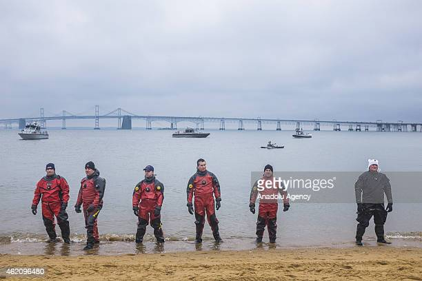 Rescue swimmers prepare for thousands of people to run into the frigid water at the 19th Annual Maryland State Police Polar Bear Plunge at Sandy...
