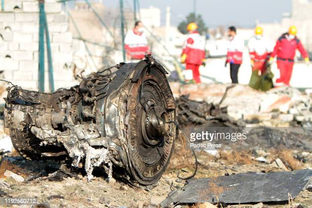 Rescue team at the crash site of a Ukrainian airliner that burst into flames shortly after take-off from Tehran on Wednesday, killing all 176 people...