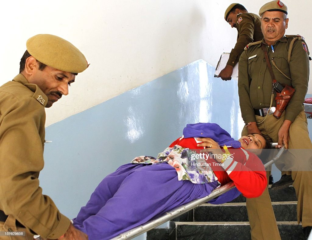 Rescue team carrying out an woman pretend to be injured during a mock drill at Birla Vidya Niketan, South Delhi on December 4,2102 in New Delhi, India. Mock Drill performs at various place in the capital to test the alertness and responds during the time of emergency situation such as Earthquake, Fire, Bomb Blast.