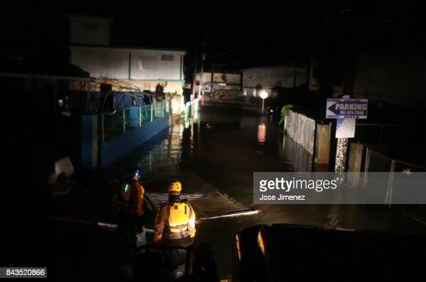 A rescue team from the local emergency management agency inspects flooded areas after the passing of Hurricane Irma on September 6 2017 in Fajardo...