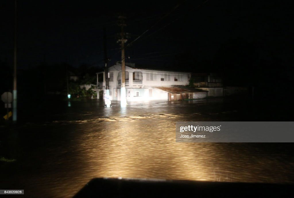A rescue team from the local emergency management agency inspects flooded areas after the passing of Hurricane Irma on September 6, 2017 in Fajardo, Puerto Rico. The category 5 storm is expected to pass over Puerto Rico and the Virgin Islands today, and make landfall in Florida by the weekend.