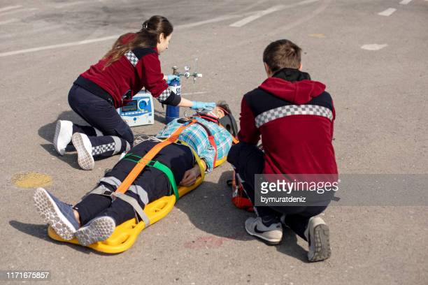 rescue team helping - myocardium stock photos and pictures