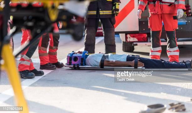 Rescue Team Helping Victim Of Car Crash