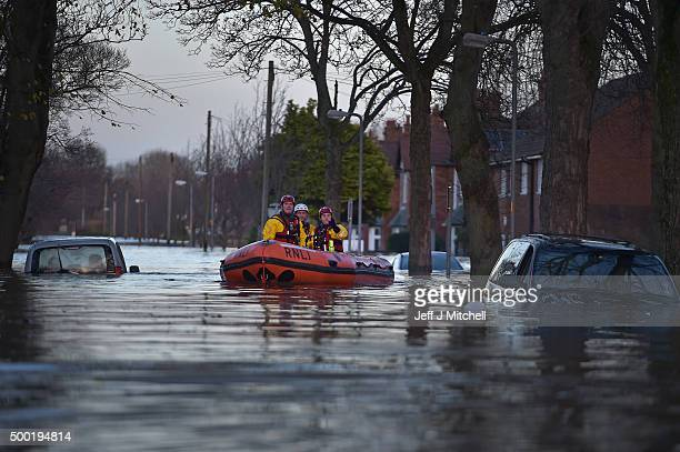 A rescue team helps to evacuate people from their homes after Storm Desmond caused flooding on December 6 2015 in Carlisle England Storm Desmond has...