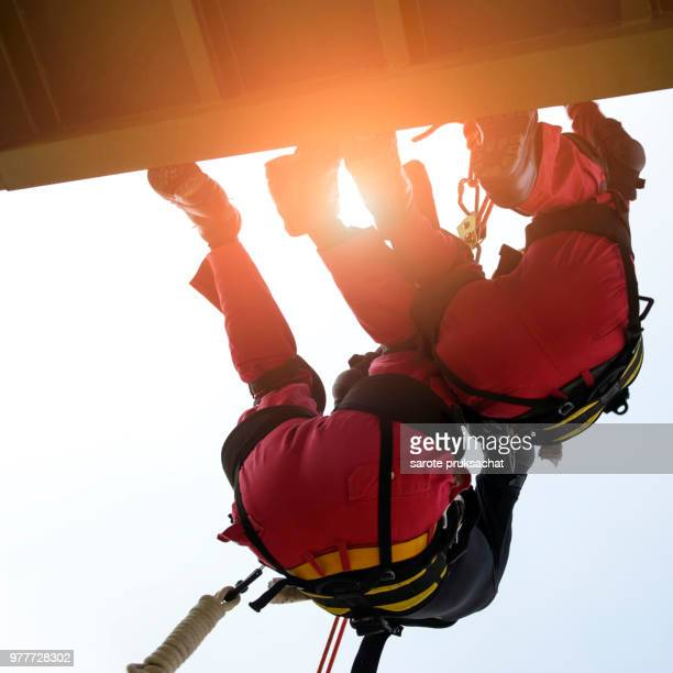 Rescue team in action practicing in climbing equipment . Rescue concept.