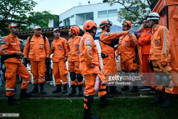Rescue team members prepare to search for survivors after the tourist boat 'Almirante' sank in the Reservoir of Penol in Guatape municipality in...