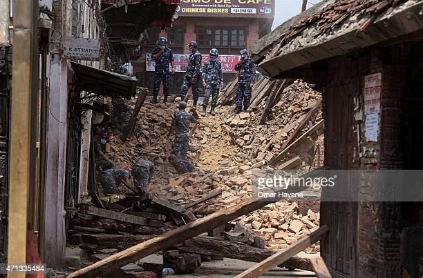 Rescue team members search for bodies in the debris of a collapsed temple at Basantapur Durbar Square on April 27, 2015 in Kathmandu, Nepal. A major...