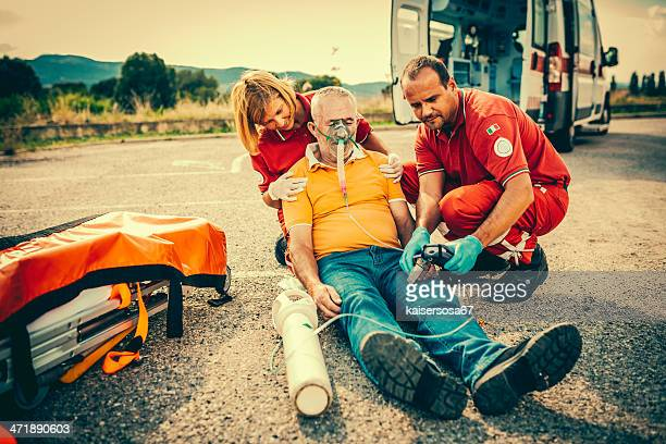 rescue team providing first aid - rescue worker stock pictures, royalty-free photos & images