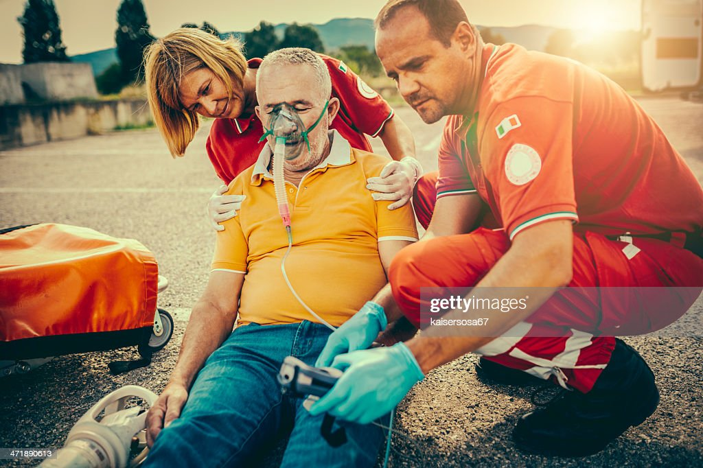 Rescue Team Providing First Aid : Stock Photo