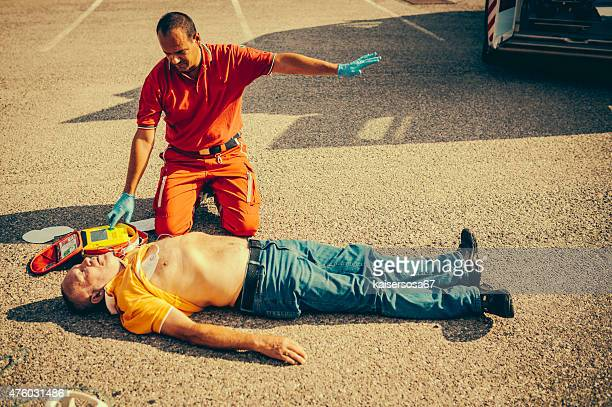 rescue team providing first aid - myocardium stock photos and pictures