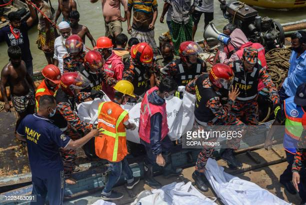 Rescue team recovering bodies from Buriganga River. A passenger vessel got hit by another launch and sank in the Buriganga river near the Dhaka river...