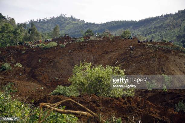 Rescue team search for more than two dozen people who were missing after a raintriggered landslide struck a village in Ponorogo East Java Indonesia...