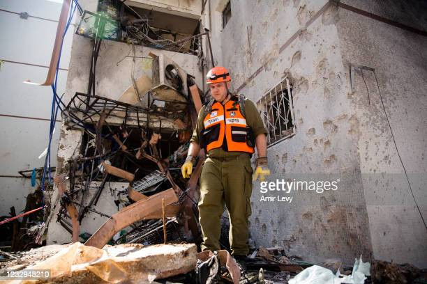 Rescue team soldier checks the site of a rocket strike from the Gaza Strip on May 17, 2021 in Ashdod, Israel. In a press conference on Sunday,...