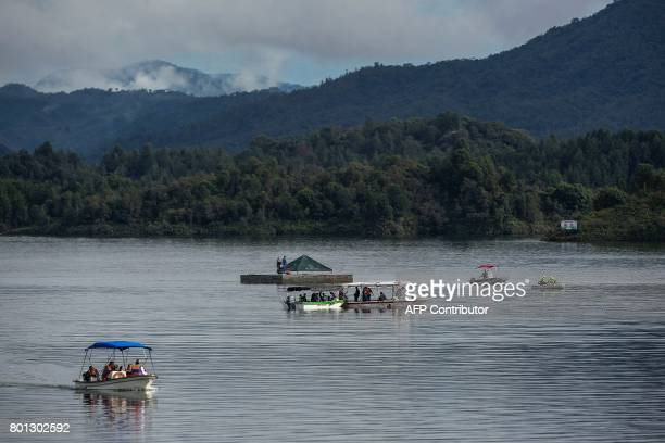A rescue team takes part in the search for survivors after the tourist boat Almirante sank in the Reservoir of Penol in Guatape municipality in...
