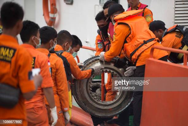 TOPSHOT Rescue team unload parts of the illfated Lion Air flight JT 610 recovered during search operations from the sea at Jakarta port on November 3...